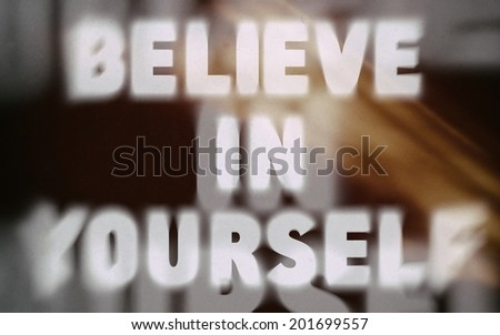 Believe in yourself word on vintage blurred background, concept sign - stock photo