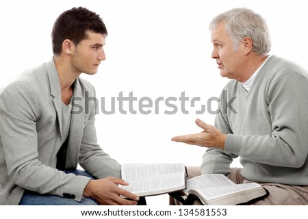 Believer explains God's Words to a young man - stock photo