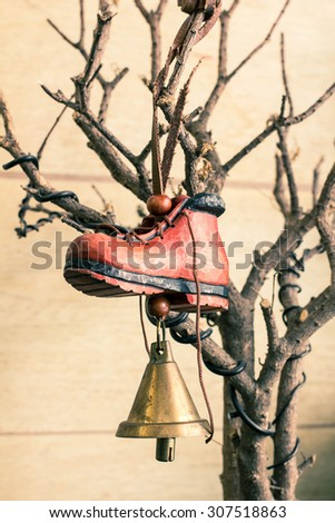 Bell and shoe wood handmade decorate on tree dry - stock photo