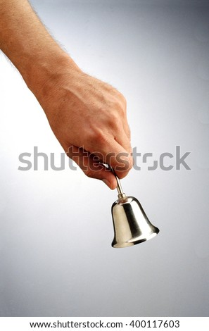 Bell in hand - stock photo