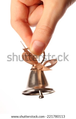 Bell in the female hand - stock photo