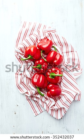 Bell peppers on a tea towel - stock photo