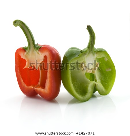 Bell peppers red and green cut open with seeds showing. High resolution image. Subject isolated on white background. - stock photo