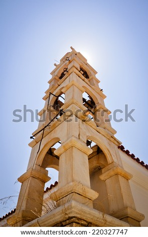 Bell tower and sunlight. Paleo Karlovasi - Samos island, Greece - stock photo