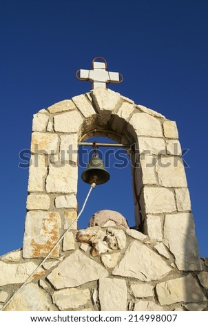 bell tower of a Greek old church in kalives port, Crete, Greece - stock photo