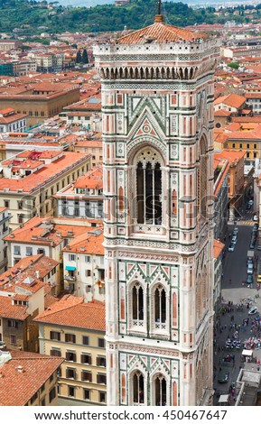 bell tower of cathedral Santa Maria del Fiore with roofs of old town, Florence, Italy - stock photo