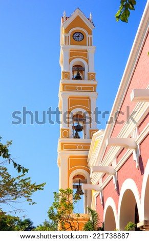 Bell tower of old Spanish church near Playa del Carmen, Mexico - stock photo