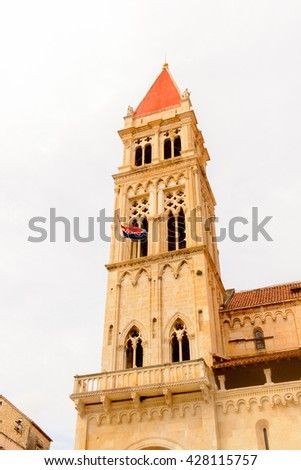 Bell tower of the Cathedral of St. Lawrence (Katedrala Sv. Lovre), a Roman Catholic triple-naved basilica constructed in Romanesque-Gothic in Trogir, Croatia. UNESCO World heritage - stock photo