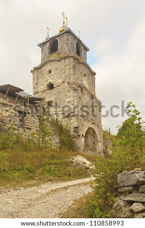 bell tower of the ruined old monastery - stock photo