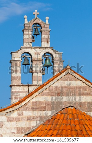 Bell tower of the Serbian Orthodox Church in the Gradiste monastery, Montenegro - stock photo