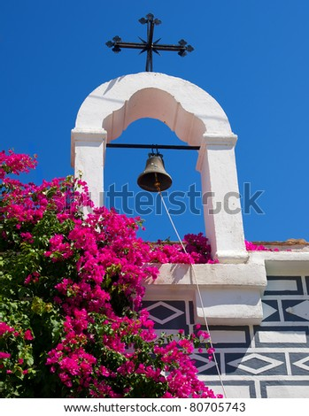 bell with Christian cross on the island of Chios - stock photo