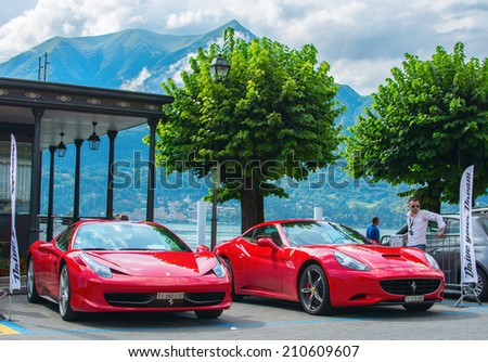 BELLAGIO, ITALY - AUGUST 1, 2014: Ferrari 458 Spider and Ferrari California for rent at the ferry terminal. Known as 'The Pearl of Lake Como', Bellagio is a popular tourist resort since Roman times. - stock photo