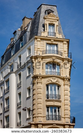 Belle epoque style building in the 12th arrondissement, Paris, France with faux balconies, wrought iron railings and slate Mansard roof. Built in 1900. - stock photo