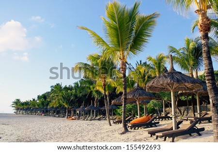 Belle Mare beach by sunrise in Mauritius - stock photo