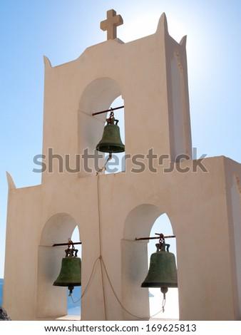 Bells on white little church on greek island, Santorini, Greece. - stock photo