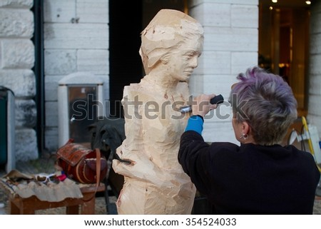 Belluno, Italy. 6.11.2015. The Ex Tempore is a sculpture contest  organized in Belluno during the festivities in honor of Saint Martin. The sculptors are distributed in the old evocative city squares. - stock photo