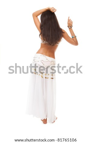 belly dancer from the back. studio shot. - stock photo