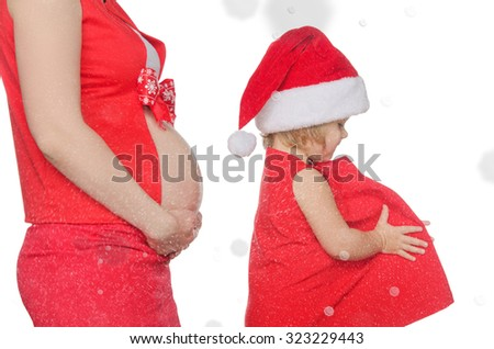 belly of pregnant woman and child on Christmas and snowflakes - stock photo