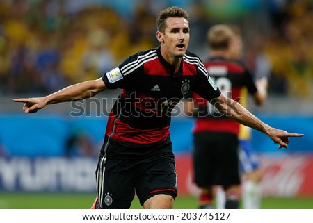 BELO HORIZONTE, BRAZIL - July 8, 2014: Miroslav Klose of Germany celebrates after scoring a goal during the World Cup Semi-finals game between Brazil and Germany at Mineirao Stadium. NO USE IN BRAZIL - stock photo