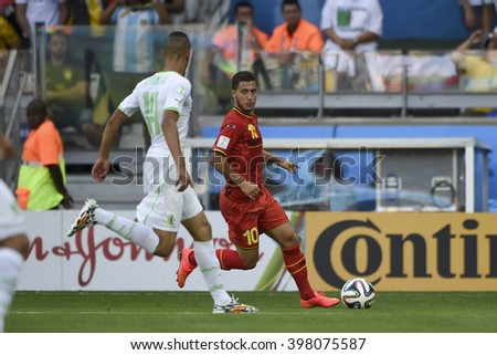 BELO HORIZONTE, BRAZIL - June 17, 2014: Eden HAZARD of Belgium compete for the ball during the World Cup Group H game between Belgium and Algeria at Mineirao Stadium.  - stock photo