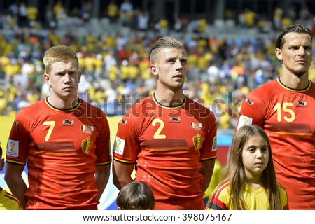 BELO HORIZONTE, BRAZIL - June 17, 2014: Kevin DE BRUYNE, Toby ALDERWEIRELD of Belgium compete for the ball during the World Cup Group H game between Belgium and Algeria at Mineirao Stadium - stock photo