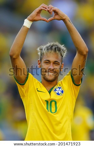 BELO HORIZONTE, BRAZIL - June 28, 2014: Neymar of Brazil celebrates winning the 2014 World Cup Round of 16 game between Brazil and Chile at Mineirao Stadium. No Use in Brazil. - stock photo