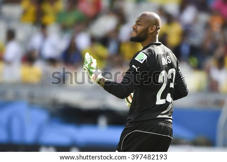 BELO HORIZONTE, BRAZIL - June 17, 2014: Rais MBOLHI of Algeria compete for the ball during the World Cup Group H game between Belgium and Algeria at Mineirao Stadium. - stock photo