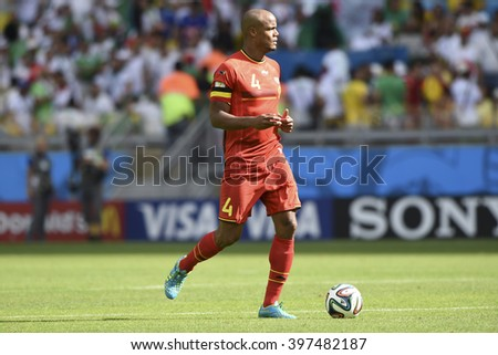 BELO HORIZONTE, BRAZIL - June 17, 2014: Vincent KOMPANY of Belgium compete for the ball during the World Cup Group H game between Belgium and Algeria at Mineirao Stadium. - stock photo