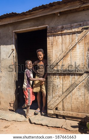 BELO SUR TSIRIBIHINA, MADAGASCAR, JUL 3:  Unidentified african children at the door of a traditional house on jul 3, 2006 in the typical village of Belo sur Tsiribihina, western Madagascar - stock photo