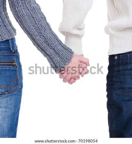 beloved couple holding hands against white background - stock photo