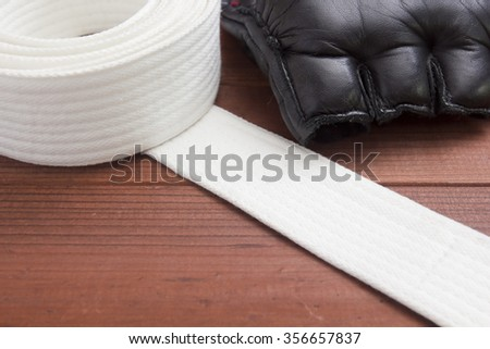 Belt - clothing accessory for karate lessons in martial arts. - stock photo