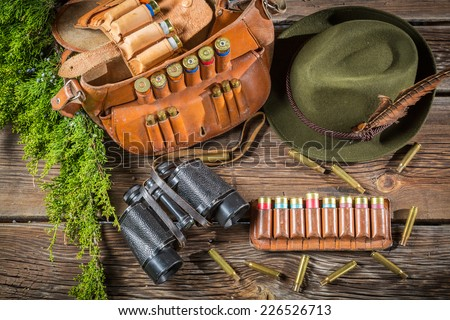 Belt with hunter bullets and binocular - stock photo