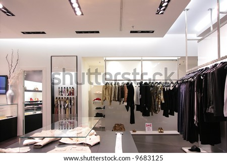 belts and upper clothes in shop - stock photo