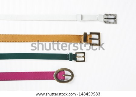 Belts. Set of different leather belts on white background - stock photo