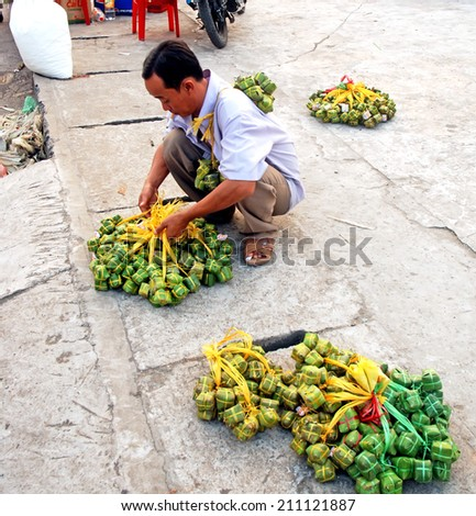 BEN TRE, VIET NAM, July 16, 2014 the man (name unknown) is preparing product, street vendor. This is their traditional cakes, bread called (chanem) - stock photo