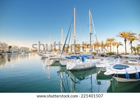 BENALMADENA, SPAIN - APRIL 29:Yachts in Marina port at dusk, in Benalmadena, Malaga, Spain on April 29, 2014. Marina port and residential complex is one of the most famous ports in costa del sol. - stock photo