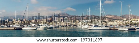 "BENALMADENA, SPAIN - DEC 19, 2013:Day view of Puerto Marina, that has won the title of ""Best Marina in the World"" several times. It has a very unusual and modern architecture on 19 december, 2013 - stock photo"