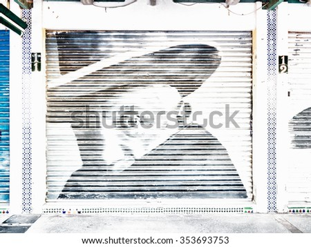 BENALMADENA, SPAIN - MAY 07: Picasso on a sliding shutter on May 07, 2015 in Benalmadena, Malaga, Spain. It belongs to the comarca of Costa del Sol. - stock photo