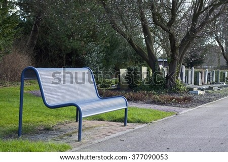 Bench at cemetery - stock photo