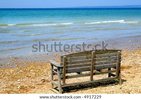 Bench at Lake shore of Mackinac in michigan - stock photo