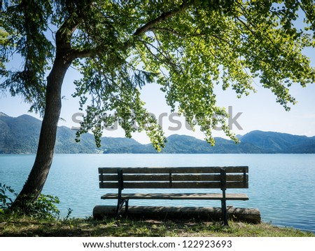bench at the walchensee in germany - stock photo