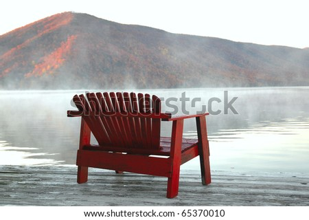 bench by lake - stock photo