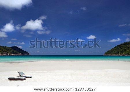 Bench by the beach - stock photo