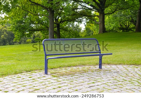 bench for relaxing in the summer park - stock photo