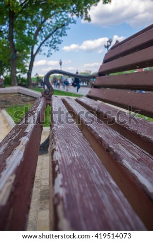 Bench in a city Park in the spring season, closeup - stock photo