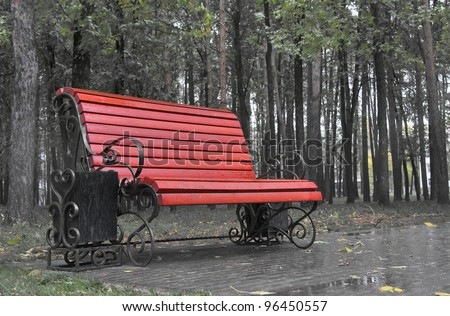 Bench in a rainy park - stock photo