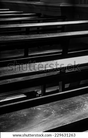 bench in church in low key  - stock photo