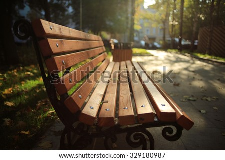 bench in the autumn park, recreation - stock photo