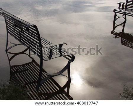 Bench in the clouds  - stock photo