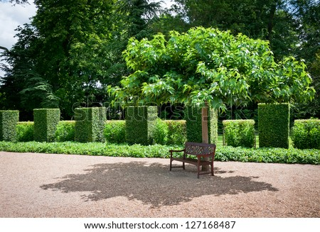 Bench in the garden of Chateau Cheverny, Loire Valley, France - stock photo